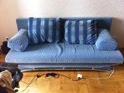 Диван-кровать и ковер